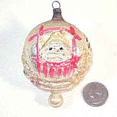 German Santa in Window Glass Christmas Ornament. Click on the image for more information.