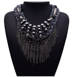 This Bohemia style exaggerated vintage chain is designed with metal tassels and rivets accentuated with spreckles of gold and black beads.     Pre-Order item - Please allow 2 weeks delivery     Features:   *Style: Bohemia  *Material: Resin  *Chain Type: Snake Chain  *Length: 16.92 Inches   *Weigh...