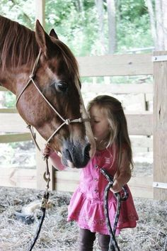 Little girl cute as a button with her horse
