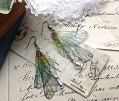 "Rather pretty ""Rainbow Faerie wing earrings"""