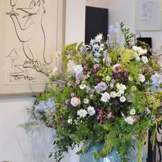We love working @russets_country_house - it's super loveky spotless and they welcome all suppliers with a proper cuppa! We created these urns at the bottom of the stairs for Lucy at the weekend. Roses delphiniums penstemon mint purple basil Nigella & scabious