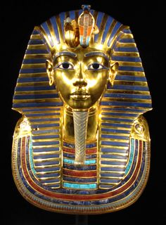 """""""Tutankhamun's Treasures"""" of the shrines, the coffins and the mask surrounding Tutankhamun's mummy, and other items such as statues, jewellery, a throne, Canopic jars, a dagger, a game, and a chariot."""