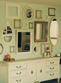 wall of vintage mirrors. by selena