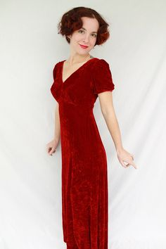 Gorgeous 1960s Crimson Red Crushed Velvet Empire Waist Dress with Puffed Sleeves Size Small - AS IS. $30.00, via Etsy.