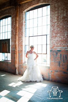 Bridal portrait with shadow and light patterns through window at McKinney Cotton Mill Warehouse by http://tracyautem.com