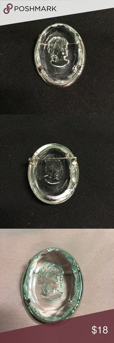 Vintage Glass Intaglio Cameo in Silver Tone Pin Vintage Intaglio Cameo on Glass set in a silver tone Brooch. 1.5 inches by 1.5 inches long. Oval shape. Jewelry Brooches