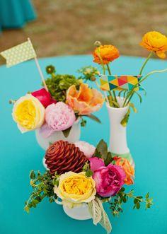 mixed flower + color centerpiece, photo by Tulle & Grace http://ruffledblog.com/aiken-backyard-wedding #weddingideas #centerpieces