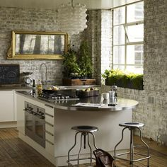 Love the gray brick in the kitchen with the white cabinets