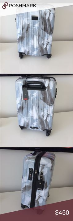 Blur Print TUMI International Carry-On NWT Blur Print TUMI International Carry-On NWT.  Note I also have the matching backpack for sale weight is 6.4 lbs so higher price to take care of the shipping upgrade- MUCH CHEAPER ON MERC Tumi Bags Travel Bags