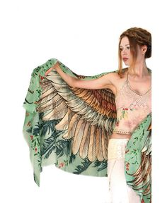 Hand painted and digitally printed Art of wide – spread wings. This highly detailed representation of nature, freedom and beauty is my labor of Love. Just put it over your shoulders to look & feel divine. This scarf would make the most amazing gift for your loved ones to treasure for years to come! FABRIC: …