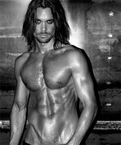 Mikael Kenta - Italian model and TV star. HAVE MERCY! Oh, I have NO idea if he sings. I just like to look at him. ;)