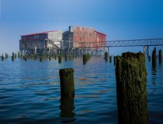 """Sitting on pilings 50 yards out into the river, """"Big Red,"""" the Union Fishermen's Cooperative Packing Co.'s net loft, was built in 1897 and used by the fishing and marine industry for 90 years. It primarily served as a transfer station for fish and a drying structure for wet nets."""