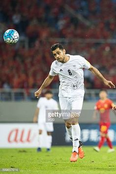 Morteza Pouraliganji of Iran heads the ball during the 2018 Russia World Cup Asia Qualifiers match between China and Iran at Shenyang Olympic Stadium...