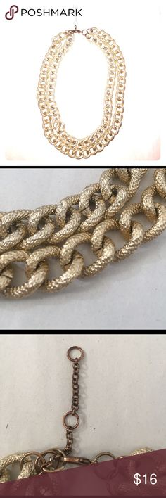 Gold Chain Link Necklace Double layered gold chain link necklace. Has 3 rings for adjustable length. Main clip area shows some signs of tarnish, actually chain links are in great condition. Jewelry Necklaces