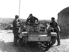 Universal Carrier Mk 1 of Australian 6th Division Cavalry in North Africa, Feb 1941; note Boys anti-tank rifle and a radio set on the Univer...