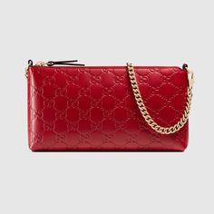 GUCCI Gucci Signature Wrist Wallet - Red Gucci Signature. #gucci #all