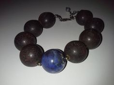 Check out this item in my Etsy shop https://www.etsy.com/listing/120624427/vulcanite-black-lava-and-kyanite-beads