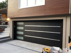 Depending on the design of your home, your garage door (or doors) can take up a lot of real estate on the front of your house. Replacing your garage door, especially if it's a standard builder-grade sectional door, with something… Continue Reading → Home Depot Garage Doors, Garage Door Spring Repair, Garage Doors For Sale, Garage Door Springs, Garage Door Makeover, Diy Garage, Small Garage, Barn Garage, Contemporary Garage Doors