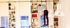 a bookshelf with a ladder is a dream come true