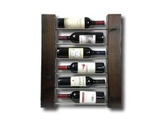 WINE RACK This modern/minimalist wine rack can be mounted on the wall or sit on the counter or floor. The cedar wood is set on fire and charred according to the traditional Japanese woodworking technique of Shou Sugi Ban. The burning exposes unique colors in the wood and unexpected #winerack
