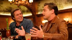 Leonardo DiCaprio and Brad Pitt star in Tarantino's love letter to Hollywood, which features Margot Robbie as Sharon Tate and takes place in the lead-up to the Charles Manson family murders. Sharon Tate, Leonardo Dicaprio, Brad Pitt, Charles Manson, Steve Carell, Steve Buscemi, Jin Won, Once Upon A Time, Robert Richardson