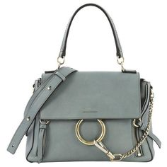 View this item and discover similar for sale at - This Chloe Faye Day Bag Leather Small, crafted from blue leather, features a leather top handle, flap top with chain-clip and ring detail, dual side zips Purple Leather, Black Patent Leather, Tan Leather, Chloe Brand, Chloe Purses, Shopping Totes, Day Bag, Leather Handle, Fashion Handbags