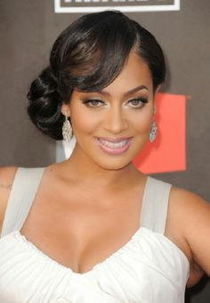 Short Bob Hairstyles with Bangs are perfect prom hairstyle idea for African American girl who loves low side buns for medium length to short hair.