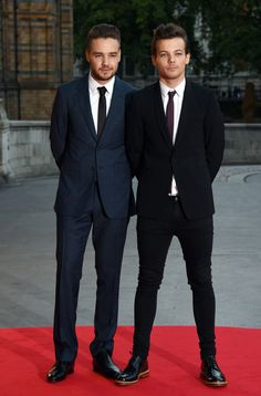 One Direction bandmates Louis Tomlinson and Liam Payne attend the Believe in Magic Cinderella Ball at Natural History Museum on August 10, 2015 in London, England.