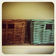 Spruce up tired baskets with a little spray paint.  Cheap and easy.