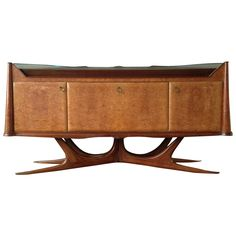 Amazing Sideboard Attributed to Osvaldo Borsani | From a unique collection of antique and modern sideboards at https://www.1stdibs.com/furniture/storage-case-pieces/sideboards/