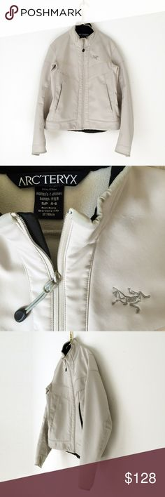"ARC'TERYX TRIDENT soft shell fleece jacket women s ARC'TERYX   minimalist. quick dry. water resistant. warm, breathable.  reflective piping. deep int. pockets. zip pockets. light beige.  women s, 4/6  laid flat, seam - seam, chest: 19"" shoulders: 16"" shoulder to cuff: 24"" nape to hem: 22""    kept with care.  pet/smoke free. 3 very light small spots, small area of puckering by logo, see closeups.  polartec snow ski barbour patagonia running softshell yoga outdoor patagonia bogner moncler…"