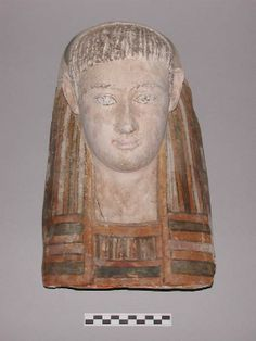funerary equipmentName:cartonnagePeriod:RomanDescription:mask, with upper part of cartonnageProductionPlace (legacy):Egypt, production,