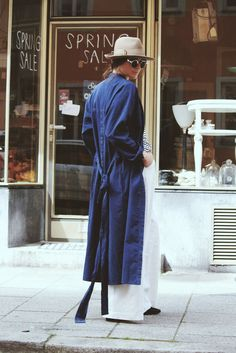 tan hat, blue trench coat & wide-leg pants #style #fashion
