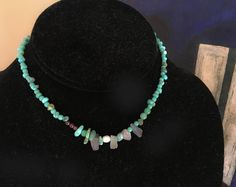 This 16 inch long boho chic choker necklace is designed with different shaped turquoise mixed with pearl, garnet, and sea glass. Visit and if you like what you see — share SuddenlySeen @Etsy choose from our collection of semi-precious stone #leslieknowlton designer necklaces, John Hardy, Konstantino jewelry, vintage mexican silver and more.