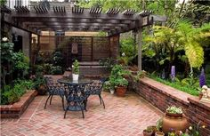 small brick patio ideas - I like this, especially the pergola thingy and the low wall.