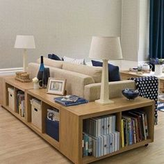 love the storage around the couch. Great for a reading light, pictures and a place to set your drink!