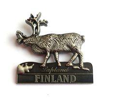 Metal souvenir fridge magnet from Finland.