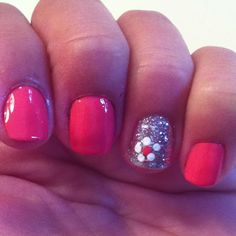 Coral nails. One finger silver glitter with flower. Flattened the tip of a toothpick to do the flower design