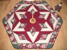 Christmas Tree Skirt constructed of 100% cotton fabrics with low-loft polyester batting...  Your tree will never look neglected before or after the presents are displayed under it with this beautiful heirloom tree skirt wrapped around the base of it...