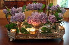 lilacs on a silver tray with votive candles