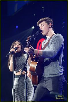 Camila Cabello & Shawn Mendes Continue Their Cuteness at Tampa Jingle Ball 2015: Photo #908133. Camila Cabello gives Shawn Mendes a sweet hug on stage during 93.3 FLZ's Jingle Ball 2015 held at Amalie Arena on Saturday night (December 19) in Tampa Bay, Fla.…