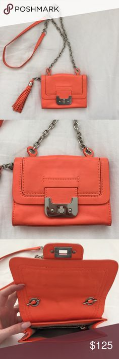 DVF Crossbody Purse An original DVF neon orange crossbody purse with a tassel and silver chain/ details. This bag is in good condition, slightly dirty but doesn't show much wear and tear. The inside is very clean. Diane von Furstenberg Bags Crossbody Bags