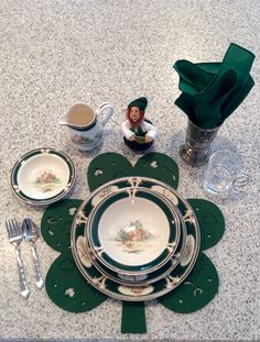 The kitchen bar gets a lot of traffic, so for St. Patrick's Day I keep it practical without a lot of fuss. Shamrock shaped placemats (Kohls), forest green napkins, & a Kindle leprechaun at each of 3 place settings embellish Noritake Ireland pattern dishes. The pewter goblets have an Irish crest.