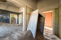 Photographer Romain Veillon recently traveled to the deserts of Namibia, where he photographed the abandoned village of Kolmanskop, an extraordinarily evocative collection of old wooden houses now filled with waves of sand. Desert Homes, Foto Art, Sand Art, Ghost Towns, Installation Art, Art Installations, Abandoned Places, Deserts, Sink