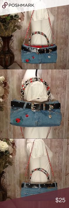 👜 Denim Blue Jeans Handbag Rhinestones New 💞 Super cute, handmade blue jean handbag, perfect for young girls/ladies, rhinestones in red, white, blue, belt has silver heart charm, black, red, silver beads on handles, red, silver braided strap, ladybug designs on front & inside, zipper pocket inside, top snap closure, small to medium, approx measurements: 12 in long, 6 in tall, 4.5 in wide, handles, 6.5 in tall, removable strap, 16 in long. Bundle to save 15% off your purchase of 2 or more…
