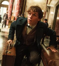 Eddie Redmayne) Hello! I'm Newt Scamander, and I'm writing a book on Magical Creatures. Had a bit of a rough time in America, so now I've got a few friends with me to help. I learned magic at Hogwarts and was in Hufflepuff. Most people find me annoying as I'm a bit ditzy, but I love people and look forward to making friends along the way! Come say hi!