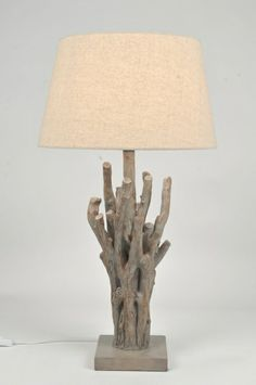 tafellamp 85475: Een zeer bijzondere sfeervolle tafellamp met beige/bruine kap. Het bijzondere aan deze staande lamp is de aparte voet gemaakt van steen met daarop een hout-look armatuur in de vorm van takken. Deze lamp is erg mooi op een tafel maar ook voor diverse andere plaatsen in uw interieur. Een absolute sfeermaker in uw huis!