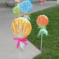 "How To Make Giant Lollipops - my daughter and I made some of these for our front yard for her 9th birthday, themed ""Sugar Rush"" (from Wreck-It-Ralph). Since her birthday was one month before Christmas, we left them up!"