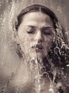 portraits with water falling on their head