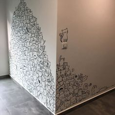 Based in Singapore, I was approached by a newly-wed couple who just got the keys to their new home. They had two cats and wanted to personalize the boring wall of their living room. I took 6 hours to complete this wall and I even added in a request to include two dogs.